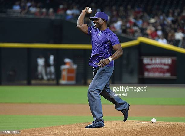 Former Arizona Diamondbacks player Orlando Hudson throws out the ceremonial first pitch prior to a game against the Cincinnati Reds at Chase Field on...