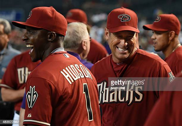 Former Arizona Diamondbacks players Luis Gonzalez and Orlando Hudson have some laughs prior to an alumni game at Chase Field on August 9 2015 in...
