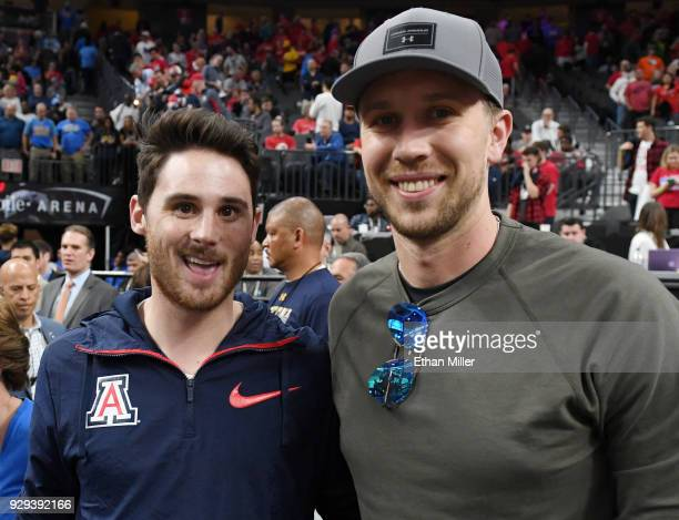 Former Arizona wide receiver David Douglas and his former teammate at Arizona quarterback Nick Foles of the Philadelphia Eagles attend a quarterfinal...