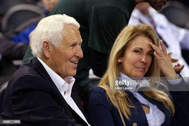 Former Arizona Wildcats head coach Lute Olson and wife Kelly Pugnea in the stands before the Duke Blue Devils take on the Michigan State Spartans in...
