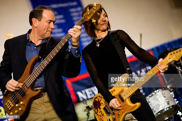 Former Arkansas Gov. And republican Presidential candidate, Mike Huckabee Joined the band Mama Kicks, with lead singer Lisa Guyer, during a campaign...