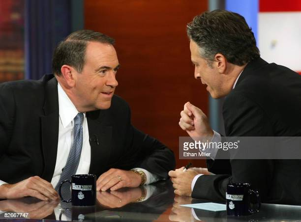 Former Arkansas Gov Mike Huckabee is interviewed by host Jon Stewart of Comedy Central's 'The Daily Show with Jon Stewart' during a taping of 'The...