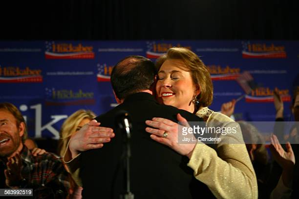 Former Arkansas Gov. Mike Huckabee with his wife, Janet, gives his acceptance speech Thursday night, January 3, 2008.