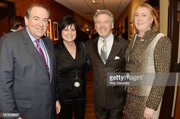 Former Arkansas Governor Mike Huckabee Janis Ross country musician Larry Gatlin and Janet Huckabee attend the funeral service for George Jones at The...