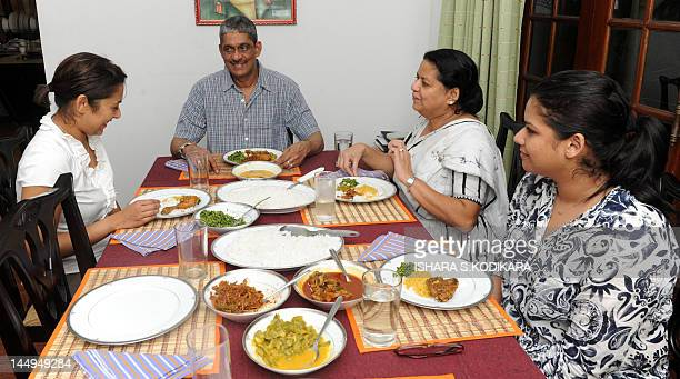 Former army chief Sarath Fonseka having a dinner with his wife Anoma and daughters Aparna and Apsara following Fonseka's release from prison at their...