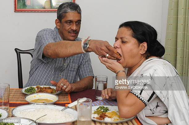 Former army chief Sarath Fonseka having a dinner with his wife Anoma following Fonseka's release from prison at their residence in Colombo on May 21...