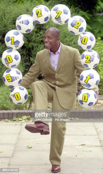 Former Arsenal and England footballer Ian Wright holds up the phone number for the inaugural National football awards outside The National Film...