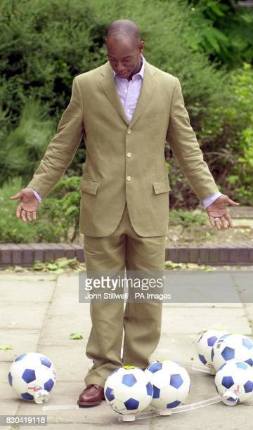 Former Arsenal and England footballer Ian Wright surveys the wreckage of the phone number football display for the inaugural National football awards...
