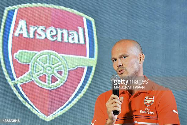 Former Arsenal footballer Fredrick Ljungberg of Sweden takes part in an interactive session with fans during the launch of Arsenal Football Club kits...