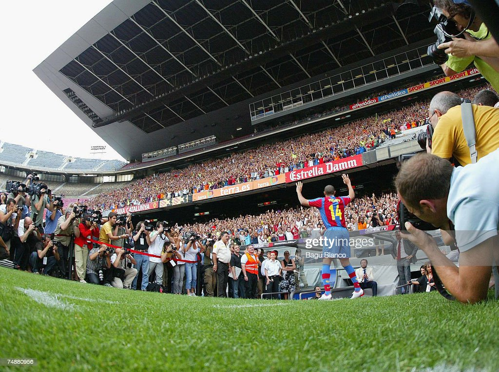 Former Arsenal forward Thierry Henry acknowledges the thousands of Barcelona fans who turned out to see him at the Nou Camp on June 25, 2007 in Barcelona, Spain.