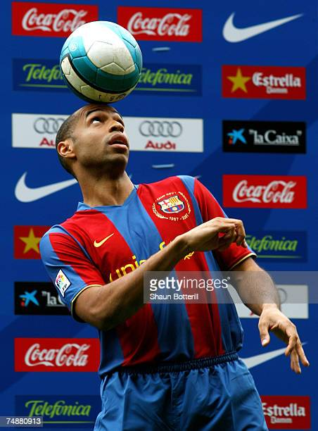 Former Arsenal forward Thierry Henry juggles the ball for the thousands of fans who turned out to see him at the Nou Camp on June 25 2007 in...