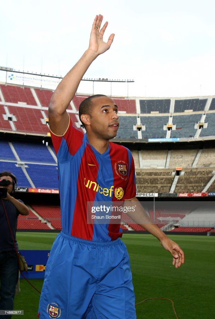 Former Arsenal forward Thierry Henry waves to the thousands of Barcelona fans who turned out to see him at the Nou Camp on June 25, 2007 in Barcelona, Spain.