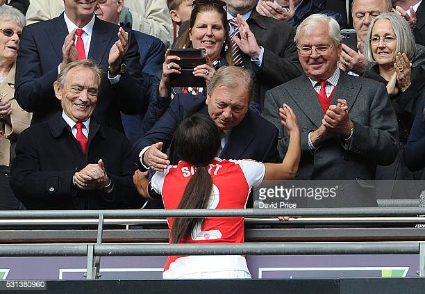 Former Arsenal Ladies Manager Vic Akers hugs Alex Scott of Arsenal Ladies as Arsenal Director Ken Friar and Arsenal Chairman Sir Chips Keswick look...