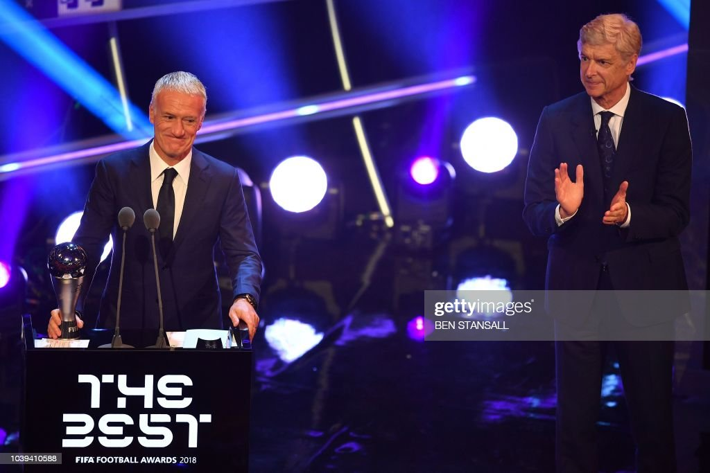 TOPSHOT - Former Arsenal manager Arsene Wenger (R) applauds as France's coach Didier Deschamps smiles after winning the trophy for the Best FIFA Men's Coach of 2018 Award during The Best FIFA Football Awards ceremony, on September 24, 2018 in London.