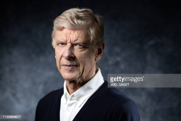 TOPSHOT Former Arsenal manager Arsene Wenger of France poses during a photo session in Paris on May 22 2019