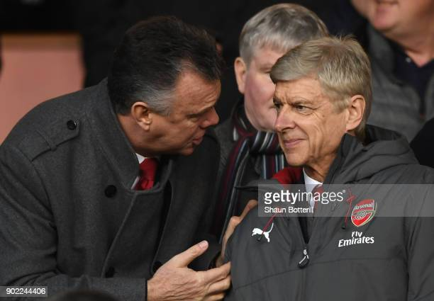 Former Arsenal player David O'Leary talks to Arsene Wenger Manager of Arsenal during The Emirates FA Cup Third Round match between Nottingham Forest...