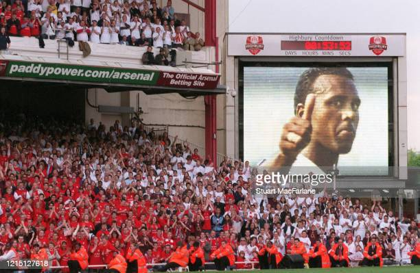 Former Arsenal player David Rocastle image is shown on the big screen after the Premier League match between Arsenal and Wigan Athletic the last ever...