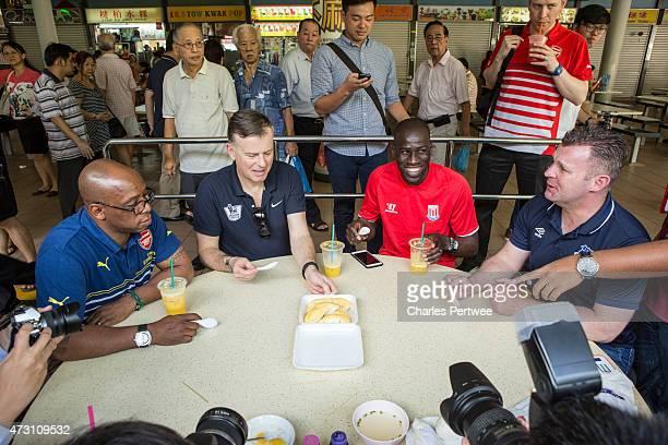 Former Arsenal player Ian Wright football pundit John Dykes former Stoke player Mamady Sidibe and former Everton player Graham Stuart try durian...