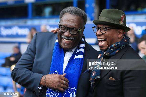 Former Arsenal player Ian Wright laughs and jokes with former West Indies cricketer Clive Lloyd before the Premier League match between Everton and...