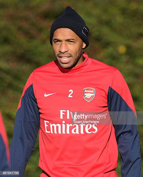 Former Arsenal player Thierry Henry training with the squad during at London Colney on November 22 2013 in St Albans England