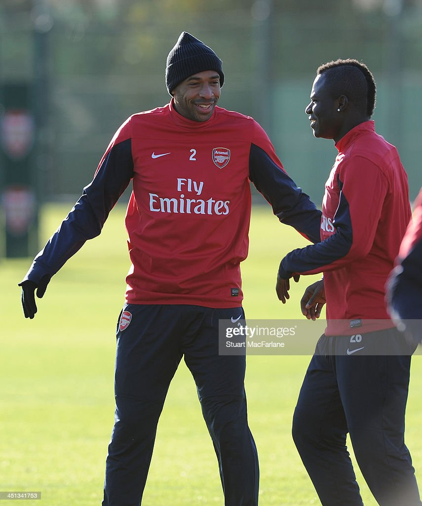 Former Arsenal player (L) Thierry Henry with current player (R) Emmanuel Frimpong during a training session training at London Colney on November 22, 2013 in St Albans, England.