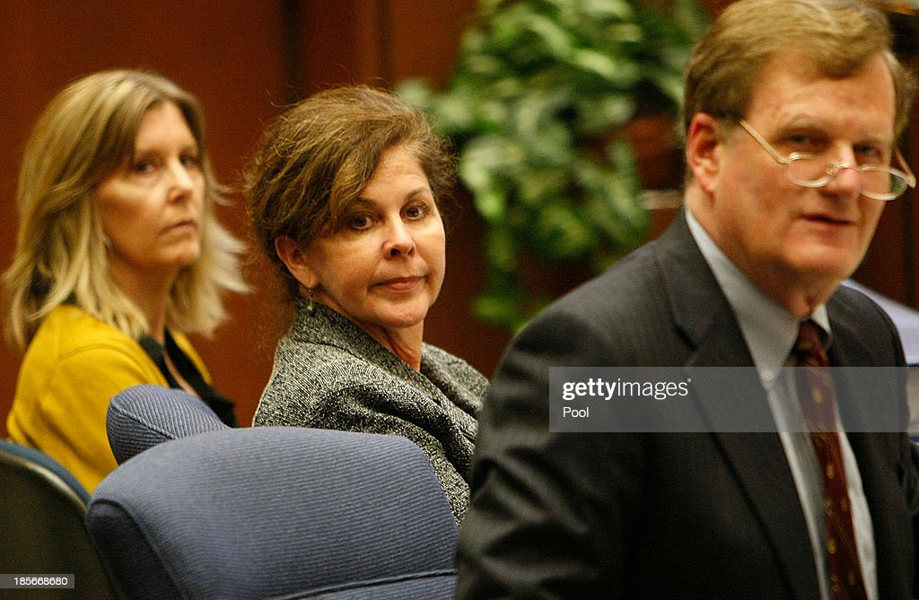 Former assistant city manager of Bell, Angela Spaccia (C), who is charged with misappropriation of public funds and other counts, listens to opening statements in Los Angeles Superior Court on October 23, 2013 in Los Angeles, California. Spaccia, who is facing 13 corruption-related felony counts, is expected to testify in the municipal corruption case.