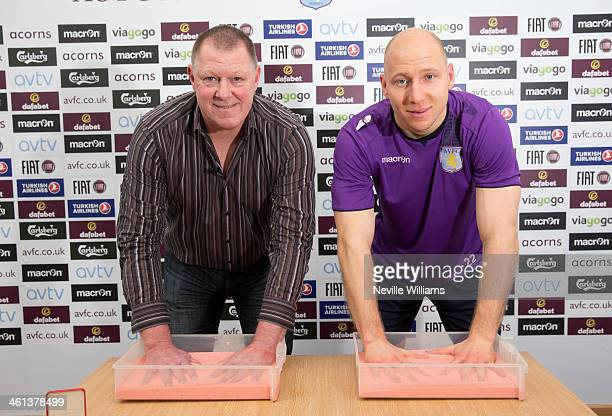 Former Aston Villa goalkeeper Nigel Spink and Aston Villa goalkeeper Brad Guzan have moulds of their hands made for the Aston Villa Heritage Zone at...