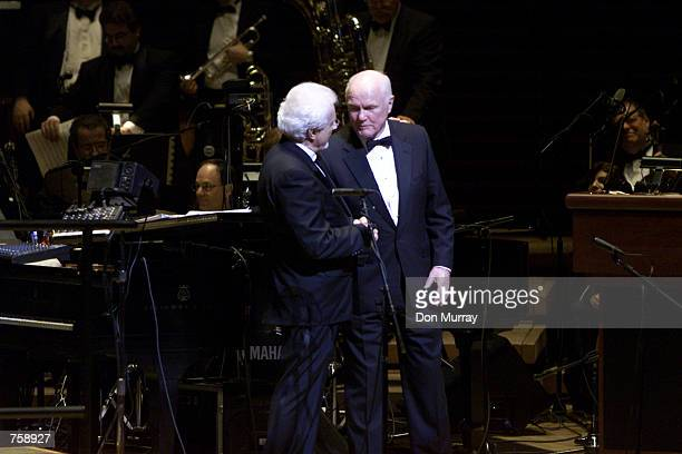 Former astronaut and Ohio Senator John Glenn presents a CD to Peter Nero after their performanceof the 'Voyage into Space'''' with the Philly Pops at...