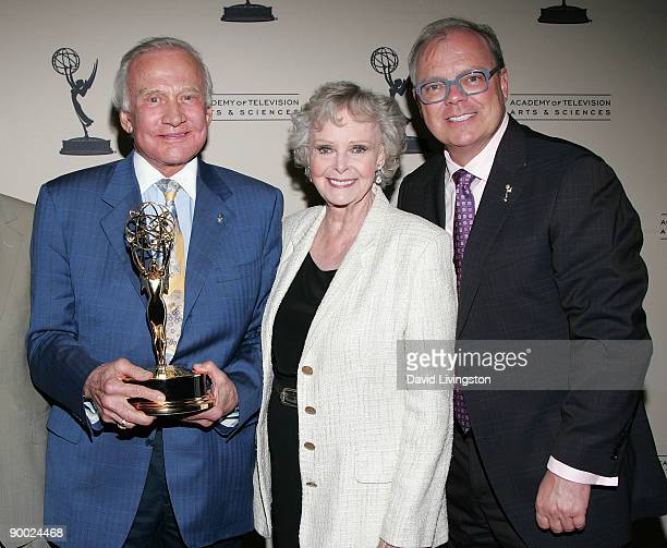 Former astronaut Buzz Aldrin holding the Philo T Farnsworth Corporate Achievement Award he accepted on behalf of NASA actress June Lockhart and the...