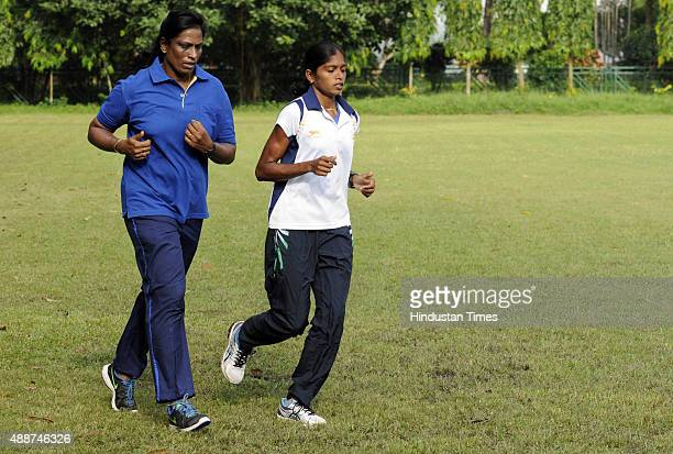 Former athlete and now coach PT Usha training with her protégé Asian Games medalist Tintu Lukka during a training session at 5he 5th National Open...