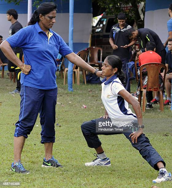 Former athlete and now coach PT Usha training with her protégé Asian Games medalist Tintu Lukka during a training session at the 55th National Open...