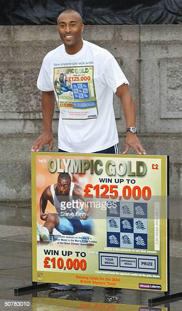 Former athlete Colin Jackson helps launch the new British Olympic Association 'Olympic Gold' Scratchcard in Trafalgar Square on April 29 2004 in...