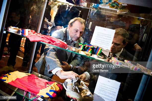 Former athlete Fermin Cacho places the shoes he wore when winning the 1500m at the 1992 Barcelona Olympic Games during the IAAF Centenary Exhibition...