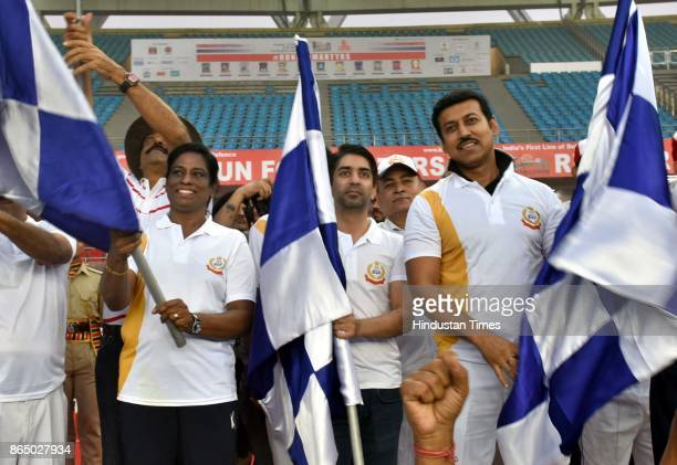 Former athlete PT Usha Abhinav Bindra and Raghvendra Singh Rathore flag off the 'Run for Martyrs' organised by Border Security Force a tribute to...