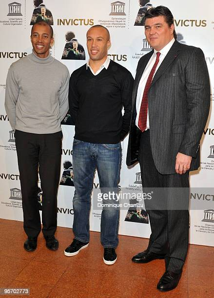 Former athlete Stephane Diagana football player Mikael Silvestre and athlete David Douillet attend the Invictus Paris premiere at UNESCO on January...