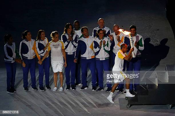 Former athlete Vanderlei de Lima carries the Olympic Torch during the Opening Ceremony of the Rio 2016 Olympic Games at Maracana Stadium on August 5...