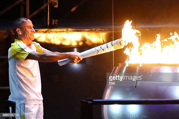 Former athlete Vanderlei de Lima lights the Olympic Flame during the Opening Ceremony of the Rio 2016 Olympic Games at Maracana Stadium on August 5,...