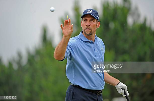 Former Atlanta Braves pitcher, and Major League Baseball All-Star John Smoltz warms up on the range during the first round of the South Georgia...