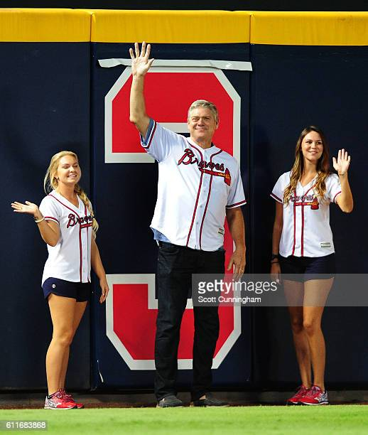 Former Atlanta Braves player Dale Murphy acknowledges the crowd after being introduced to remove the number three for the games remaining at Turner...