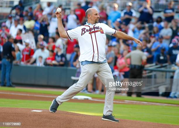 Former Atlanta Braves player John Smoltz throws out the first pitch prior to an MLB game against the Washington Nationals at SunTrust Park on May 29...