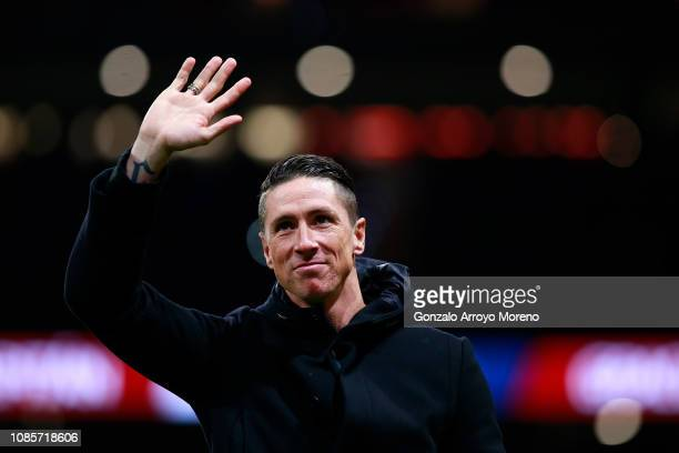 Former Atletico de Madrid player Fernando Torres waves the audience as he attends a tribute in honor of his former teammate Gabi Fernandez after the...