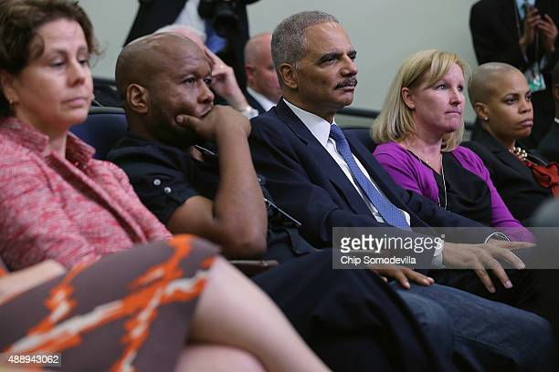 Former Attorney General Eric Holder joins hiphop artists actors justice activists state and local elected officials and community leaders that...