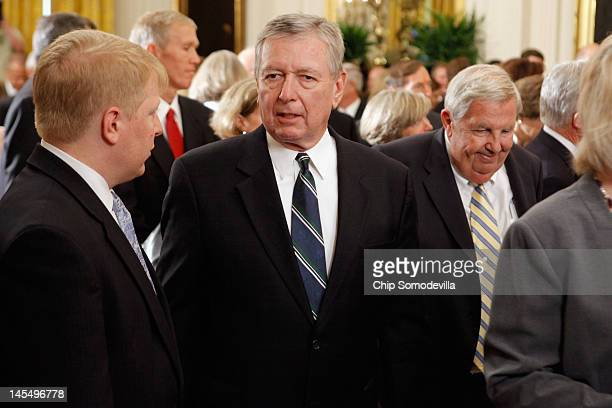 Former Attorney General John Ashcroft attends the unveiling ceremony of former President George W. Bush's offical portrait in the East Room of the...