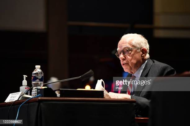 Former Attorney General Michael Mukasey testifies before the House Judiciary Committee during a hearing on oversight of the Justice Department and a...