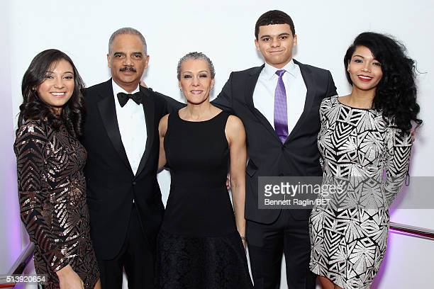 Former Attorney General of the United States Eric Holder and Sharon Malone pose with family at the BET Honors 2016 at Warner Theatre on March 5 2016...