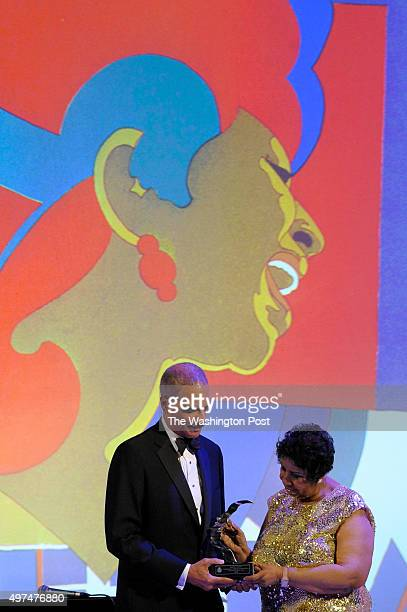 Former Attorney General of the United States Eric Holder presents the first American Portrait Prize at the National Portrait Gallery gala to Aretha...