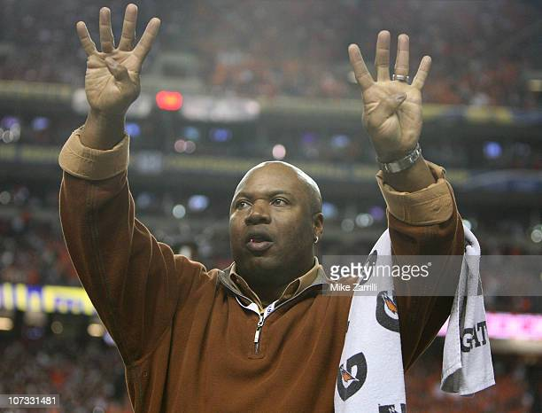 Former Auburn player Bo Jackson signals to the crowd at the start of the fourth quarter during the 2010 SEC Championship between the Auburn Tigers...