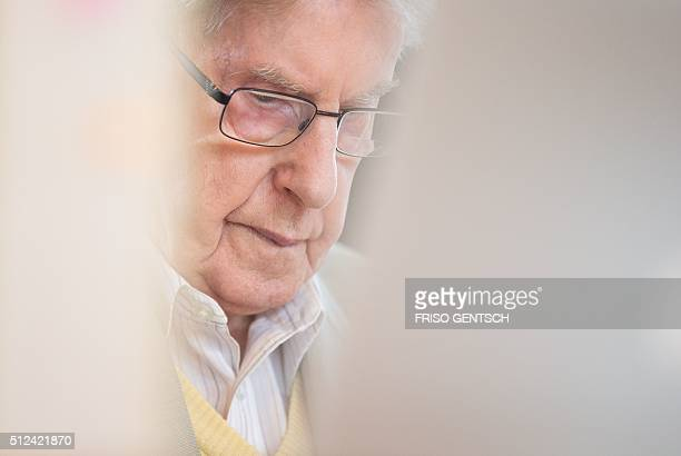 Former Auschwitz guard Reinhold Hanning is seen in court for the continuation of his trial at the court in Detmold western Germany on February 26...