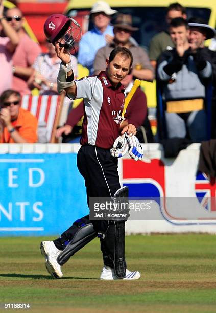 Former Australia batsman and retiring Somerset captain Justin Langer acknowledges the crowd as he waves goodbye for the final time after making 13...