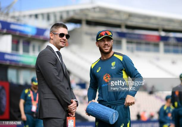 Former Australia Captain Michael Clarke chats with David Warner of Australia during the ICC Cricket World Cup 2019 Warm Up match between England and...